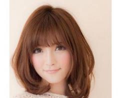 长脸女生适合的发型 时尚小脸卷发