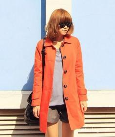 桔色风衣搭配显青春活力 给你利落之美